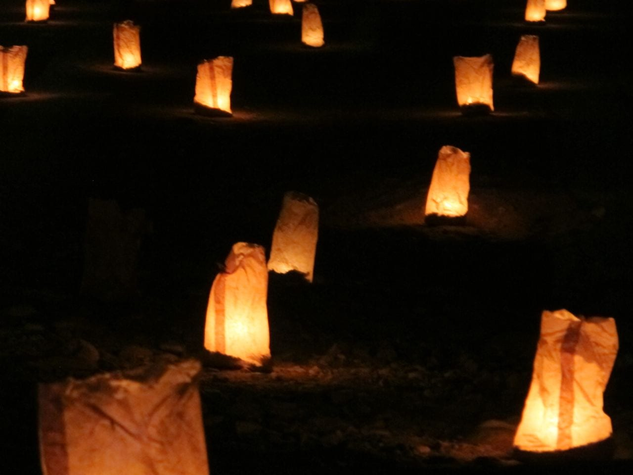 Candles light the way through the Siq